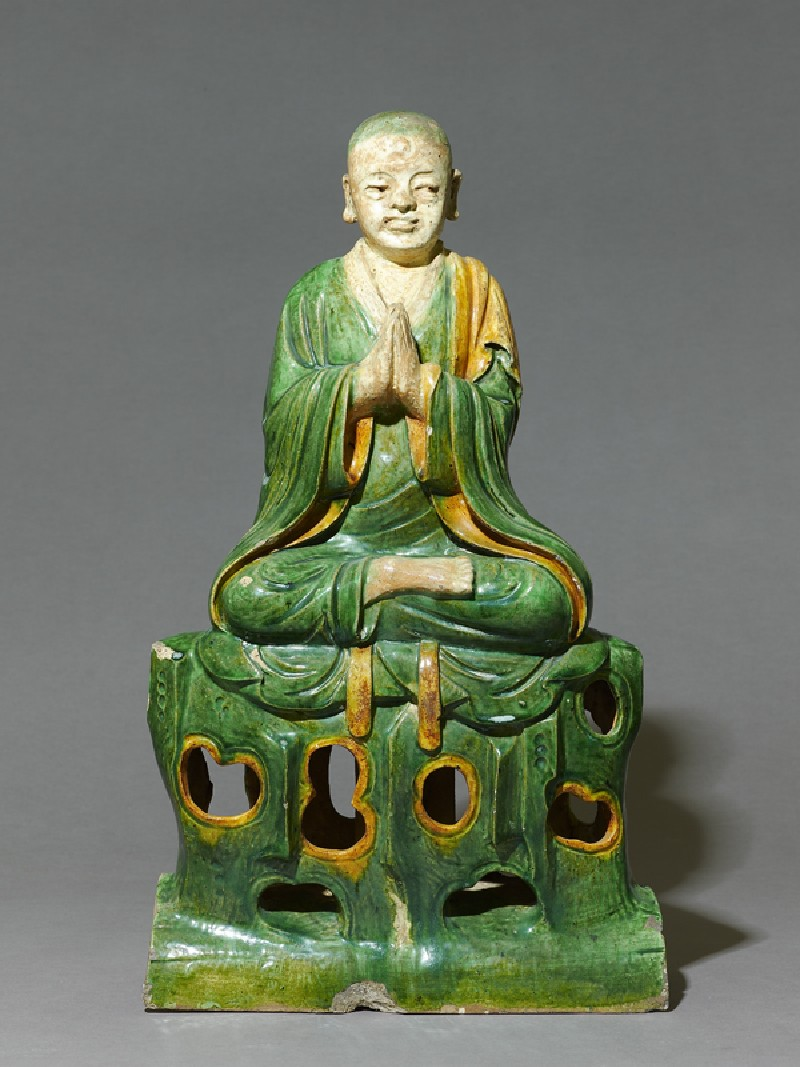 Roof ridge tile in the form of a seated Buddhist figure (EAX.3775, front          )