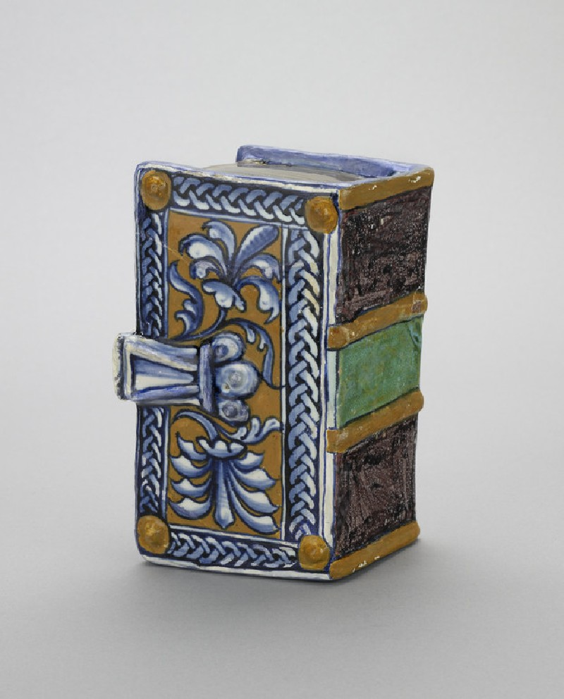 Flask or handwarmer in the shape of a book