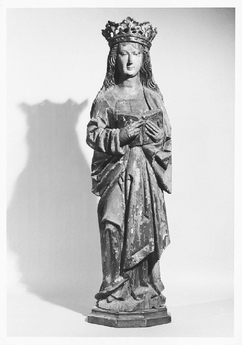 The Virgin, standing holding a book