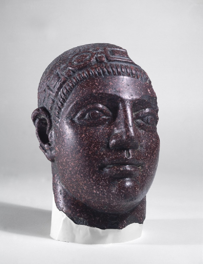 Fragmentary porphyry head of a man wearing the diadem denoting an Augustus (AN1994.58, record shot)