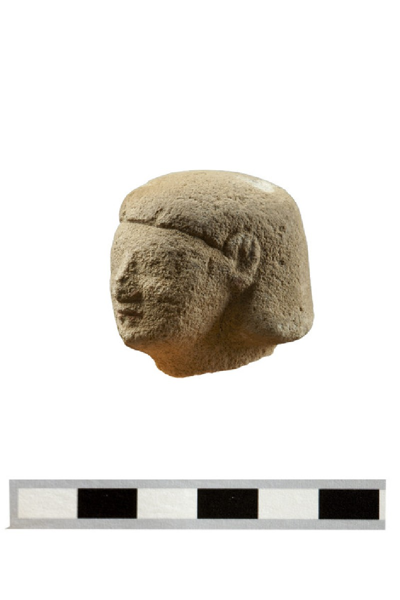 Head of fragmentary votive figure, male votary, Egyptianising style (AN1891.476, record shot)